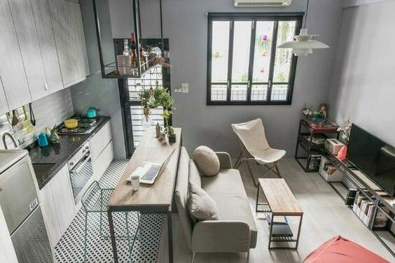 salon z aneksem kuchennym szare ściany
