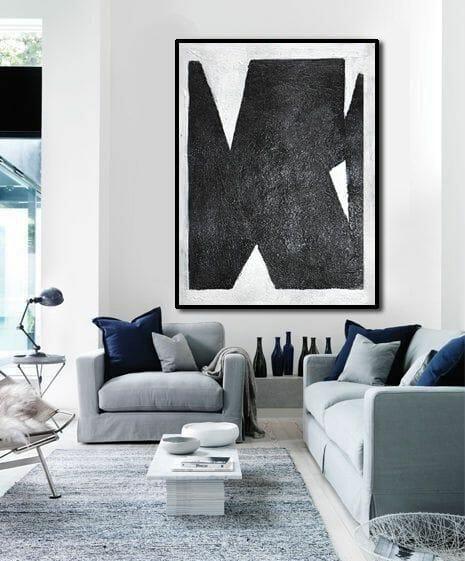 szare ściany w salonie z dodatkami biało czarnymi