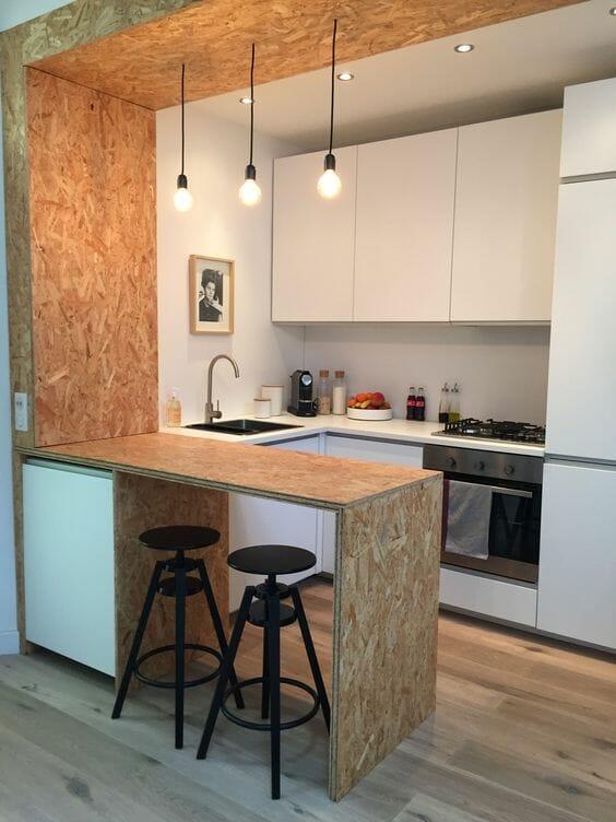 nowoczesna mała kuchnia z wyspą z dykty drewnianej